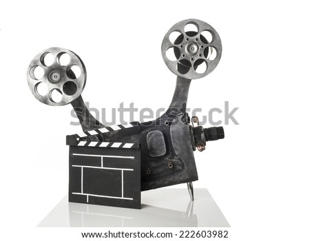 Movie projector with the film on a white background - stock photo