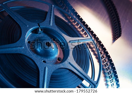 Movie reel on a metallic background - stock photo