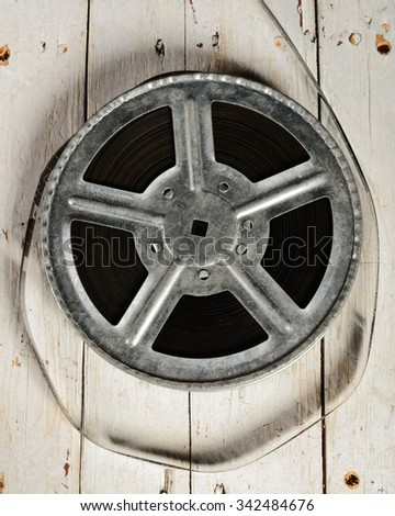 Movie reel on a  white wooden background - stock photo