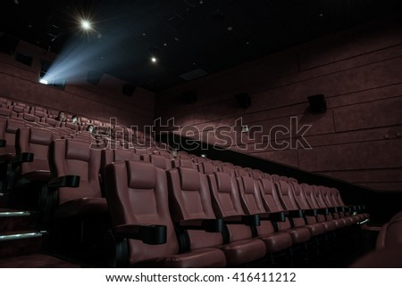 Movie theater with red seats in luxury hotel. - stock photo