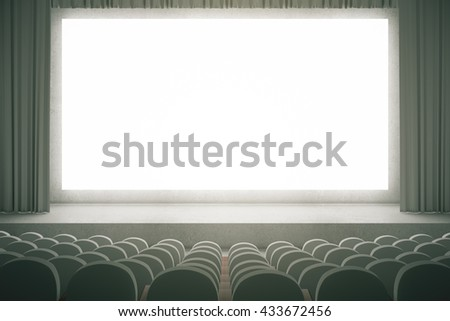 Movie theater with rows of grey seats and large blank screen with curtains. Mock up, 3D Rendering - stock photo