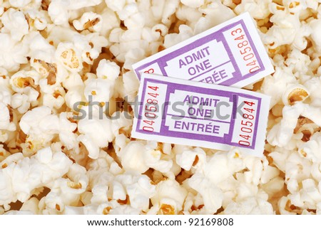 Movie tickets and popcorn - stock photo