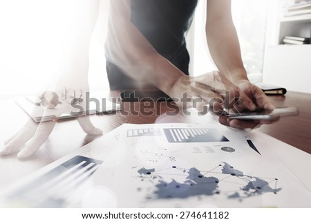 Moving Abstract Image of Business creative designer working with smart phone and tablet computer at office as concept - stock photo