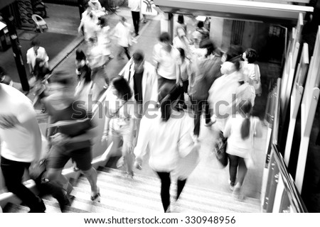 Moving blur people walking - black and white effect - stock photo