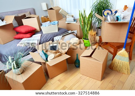 Moving boxes in new house. Real estate concept. - stock photo