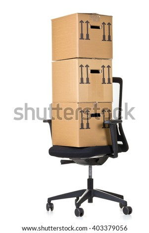 Moving boxes on  office chair over white background - office moving or relocation concept - stock photo