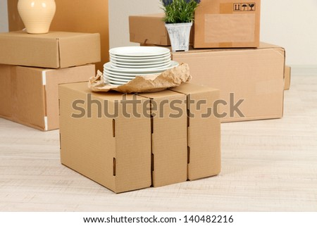 Moving boxes on the floor in empty room