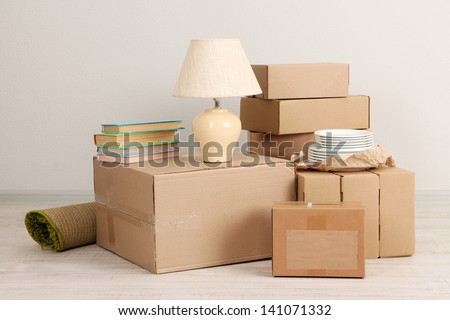 Moving boxes on the floor in empty room - stock photo