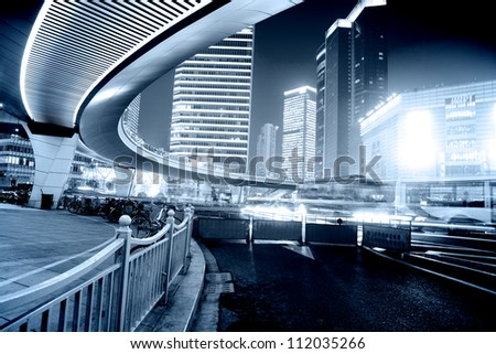 moving car with blur light through city at night in shanghai china - stock photo