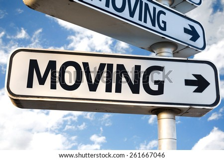 Moving direction sign on sky background - stock photo