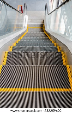Moving escalator in shopping mall - stock photo