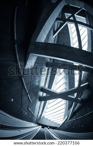 Moving escalator in the business center of a city - stock photo