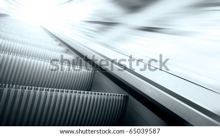 Moving escalator on the railway station - stock photo