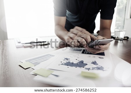 Moving Image of Business creative designer working with smart phone and tablet computer at office as concept - stock photo