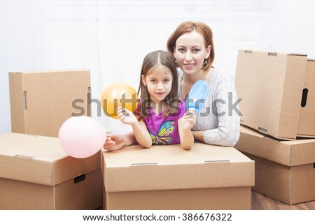 moving in the new home, cute girl and her mother - stock photo