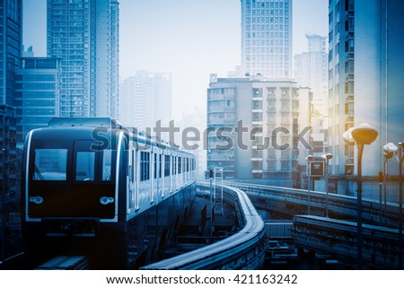 moving metro monorail in chongqing,china,blue toned image. - stock photo