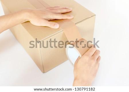 Moving shipping cardboard box - stock photo