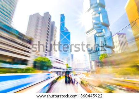 Moving through abstract modern city street with skyscrapers. Hong Kong. Abstract cityscape traffic background with moving cars. Watercolor painting effect, motion blur, art toning