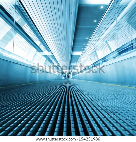 Moving walkway in modern building. - stock photo