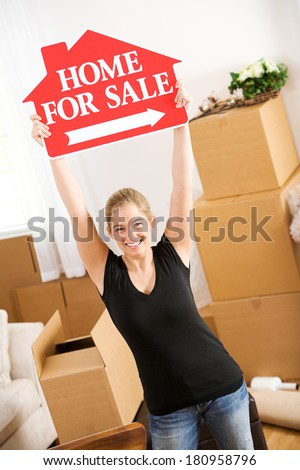 Moving: Woman Holds For Sale Sign In The Air