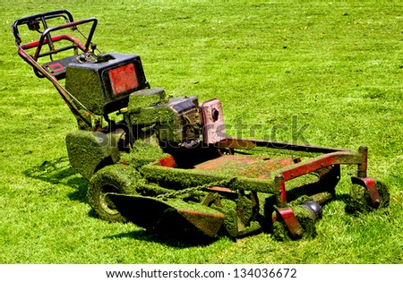 mowing machine after working hard - stock photo