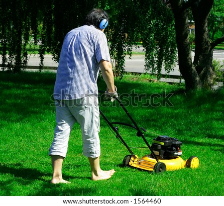 Mowing the backyard - stock photo