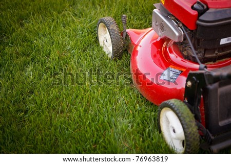 Mowing the Grass - stock photo