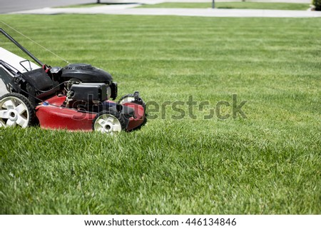 Mowing the lawn in the front yard beautiful green grass - stock photo