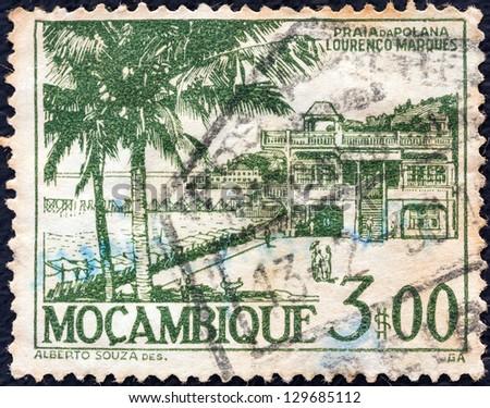 MOZAMBIQUE - CIRCA 1948: A stamp printed in Mozambique shows Polana beach, Lourenco Marques (Maputo), circa 1948. - stock photo
