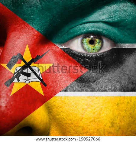 Mozambique flag painted on a man's face to support his country Mozambique - stock photo
