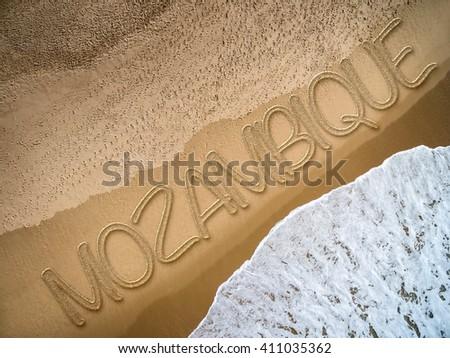 Mozambique written on the beach - stock photo