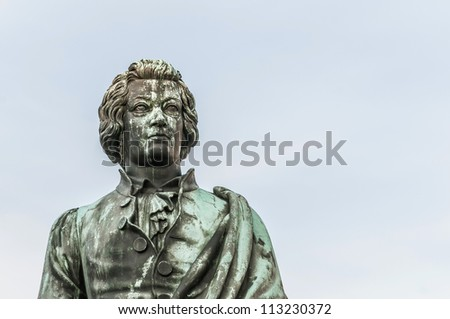 Mozart statue on Mozart Square (Mozartplatz) located at Salzburg, Austria - stock photo