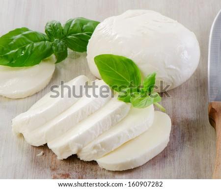 mozzarella with  basil. selective focus - stock photo