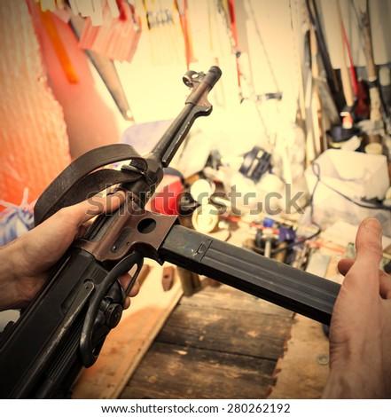 MP38 sub machine gun in the interior restoration workshop. instagram image retro style - stock photo