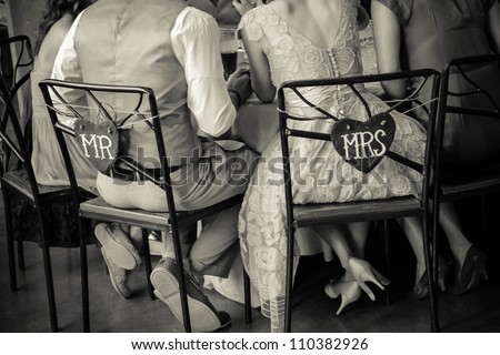 Mr. and Mrs. Chairs at Wedding - stock photo