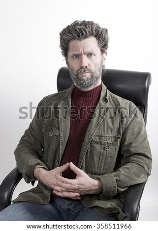 Mr. IceMan aggression, clasped his hands in front of him. fashion man in knitted sweater and jacket.