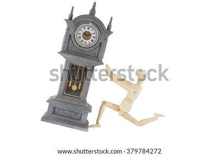 Mr. Wooden doll with old Clock - stock photo