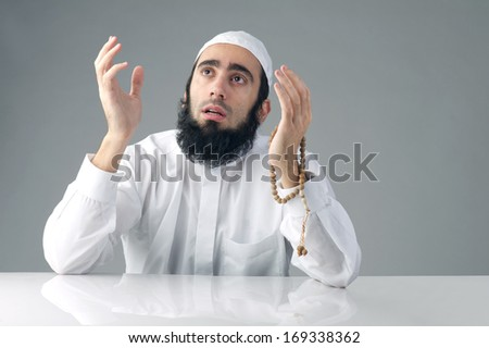 Mrabian muslim man praising God - stock photo