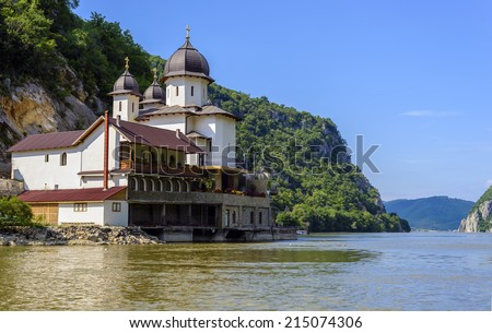 Mraconia Monastery is the only Romanian monastery built between the rocky banck of the Danube located 15 Km west of the romanian town Orsova - stock photo