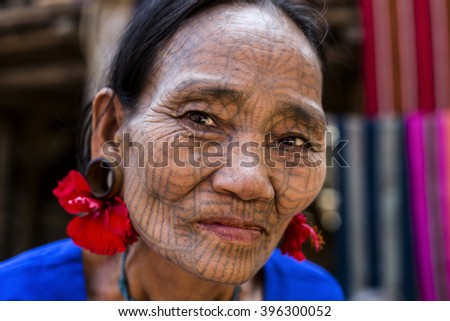 MRAUK-U, MYANMAR - JANUARY 30, 2016: A portrait of Chin woman with spider tattoo. Chin people, also known as the Kukis are a number of Tibeto Burman tribal people