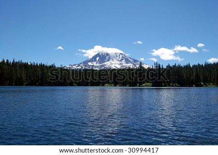 Mt. Adams behind a lake in Washington State - stock photo