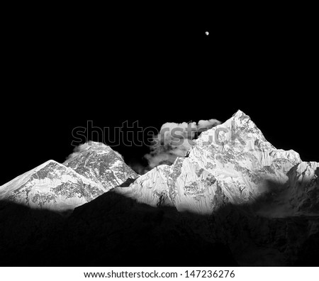Mt. Everest (8848 m) and Nuptse (7864 m) peaks at sunset (view from Kala Patthar) - Nepal, Himalayas (black and white) - stock photo