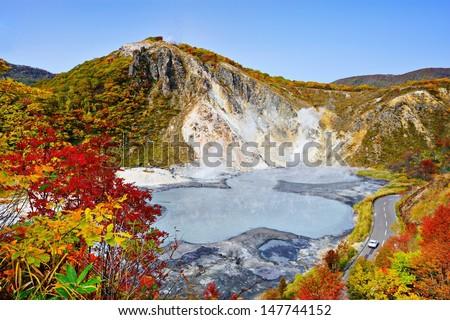 Mt. Hiyori Rises above Oyunuma Lake in Hell Valley, Noboribetsu, Hokkaido, Japan. - stock photo