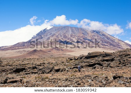 Mt. Kilimanjaro, with 5.895 m Uhuru Peak Africas highest mountain as well as worlds highest free-standing mountain. One of World`s Largest Volcanoes. - stock photo