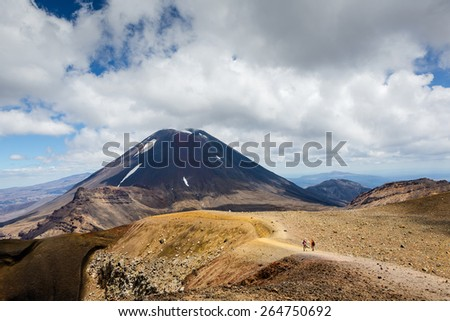 "Mt.Ngauruhoe (aka. Mt.Doom), North Island, New Zealand on a sunny morning. Part of ""Tongariro Alpine Crossing"" - stock photo"