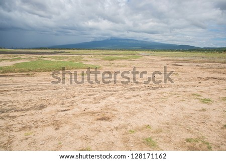 Mt. Oldeani from the shores of lake Eyasa - stock photo