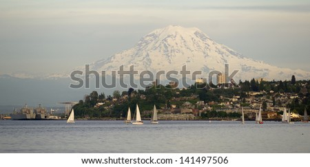 Mt. Rainier looms large over north Tacoma and Sailboats Ruston Way waterfront Nautical Landscape - stock photo