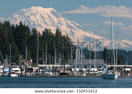 Mt Rainier Looms over Sleepy town of Gig Harbor - stock photo