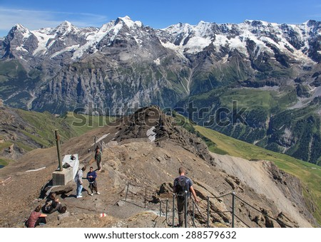 Mt. Schilthorn, Switzerland - 5 August, 2009: view on the top of the mount. The Schilthorn is a 2,970 meter high summit of the Bernese Alps in Switzerland, which overlooks the valley of Lauterbrunnen.