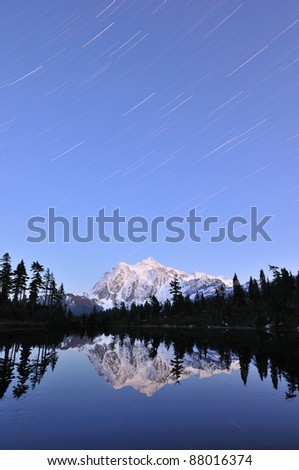 Mt. Shuksan and Picture Lake in a Starry Night - stock photo